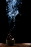 Beautiful smoke and lighting of paper burned in ceramic bow agai Stock Photography
