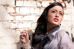 Beautiful smoking girl Stock Images