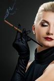 Beautiful smoking woman Stock Photography