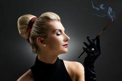 Beautiful smoking woman Royalty Free Stock Image