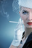 Beautiful smoking woman Royalty Free Stock Photos