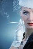 Beautiful smoking woman Royalty Free Stock Photos