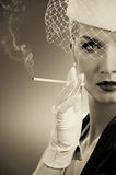 Beautiful smoking woman Royalty Free Stock Image