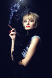 Beautiful smoking woman Stock Photo