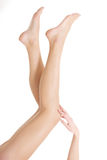 Beautiful smooth, shaved legs and feet. Royalty Free Stock Image