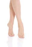 Beautiful smooth, shaved legs and feet. Isolated on white Stock Photos