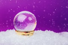 Beautiful snow ball. On snowy background over Ultra Violet backdrop Royalty Free Stock Images