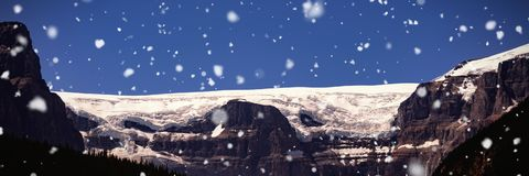 Snow capped mountain on a sunny day. Beautiful snow capped mountain on a sunny day Royalty Free Stock Photo