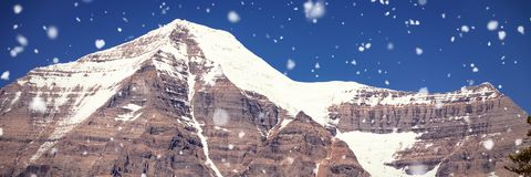 Snow capped mountain on a sunny day. Beautiful snow capped mountain on a sunny day Stock Photos