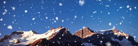 Snow capped mountain on a sunny day. Beautiful snow capped mountain on a sunny day Stock Photography
