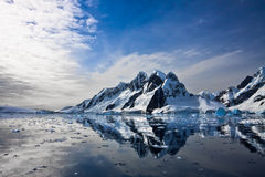 Beautiful snow-capped mountains. Against the blue sky in Antarctica royalty free stock image