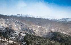 Beautiful snow-capped mountains. Snow covered mountains and rocky peaks Royalty Free Stock Photo