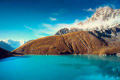 Beautiful snow-capped mountains with lake Stock Images