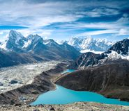 Beautiful snow-capped mountains with lake Stock Image