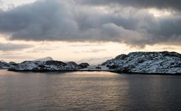 Beautiful snow coverd landscape on a boat to Lofoten. Beautiful snow coverd landscape on a boat ride to Lofoten Island Stock Photo