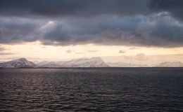 Beautiful snow coverd landscape on a boat to Lofoten. Beautiful snow coverd landscape on a boat ride to Lofoten Island Royalty Free Stock Photos