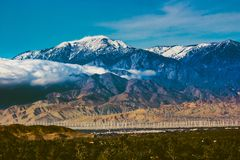 Snow Covered Mount San Jacinto. Beautiful snow-covered Mount San Jacinto rises above the Coachella Valley and San Gorgonio Pass Wind Farm, Palm Desert Stock Photo