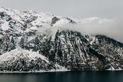 Beautiful snow-covered rocky mountains and calm mountain lake. At winter, austria stock photography