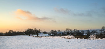 Beautiful snow covered sunrise Winter rural landscape Stock Images