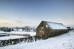 Beautiful snow covered Winter landscape at sunrise in Peak Distr. Snow covered Winter landscape at sunrise in Peak District in England Stock Photos