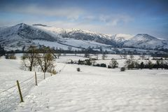 Beautiful snow covered Winter landscape at sunrise in Peak Distr Stock Photos
