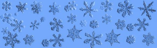 Beautiful snow flake collage on a light blue background close up royalty free stock photos