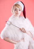 Beautiful Snow Maiden. The girl in clothes of a Snow Maiden with a magic wand Stock Photos