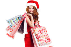Beautiful Snow Maiden with colored bags Royalty Free Stock Photos