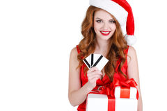 Beautiful Snow Maiden with gift and credit cards Royalty Free Stock Photography