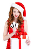 Beautiful Snow Maiden with gift and credit cards Stock Images