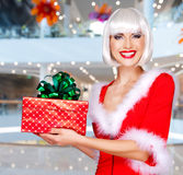 Beautiful snow maiden holds the christmas red gift box Stock Photography
