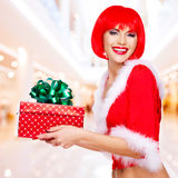 Beautiful snow maiden holds the christmas red gift box Stock Photos