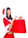 Beautiful snow maiden holds the red shopping bags Royalty Free Stock Photos