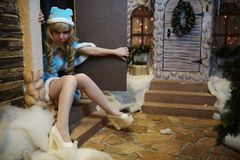 Beautiful Snow Maiden in studio Christmas interior Royalty Free Stock Photos