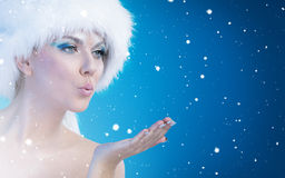 Beautiful snow queen blowing in palm Royalty Free Stock Images