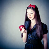 Beautiful Snow White with an apple. Fantasy portrait of the beautiful Snow White with an apple Royalty Free Stock Images