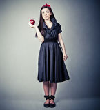 The beautiful Snow White with an apple Stock Photography