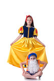 Beautiful Snow White posing with funny gnome Stock Photography