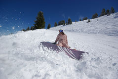 Beautiful snowboarder jumping. Picture of a snowboarder on sunny day royalty free stock image