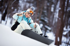 Beautiful snowboarder showing thumbs up Stock Photo