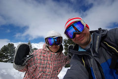 Beautiful snowboarders. Picture of snowboarders made after powder day Stock Photo