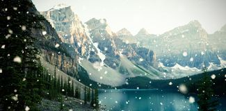 Snowcapped and lake on a sunny day. Beautiful snowcapped and lake on a sunny day Royalty Free Stock Image