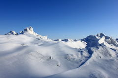 Beautiful snowdrift against the blue sky. Close-up Royalty Free Stock Photos