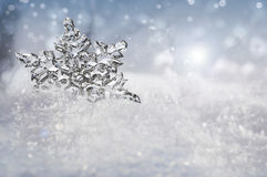 Beautiful snowflake on real snow outdoors Royalty Free Stock Image