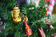 Beautiful snowman decoration toy on the artificial Christmas tree Stock Image