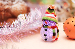 Beautiful snowman and festively decorated orange Christmas background Stock Photo
