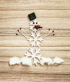 Beautiful snowman of snow flakes, matches, chocolate and chili p Stock Image