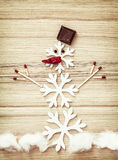 Beautiful snowman of snow flakes, matches, chocolate and chili p Royalty Free Stock Photography