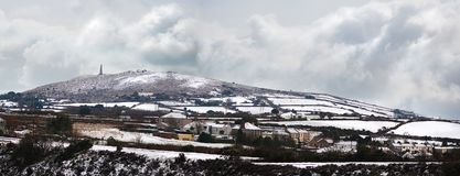 Carn brea hill covered in snow. A beautiful snowny panoramic of Carn brea hill, Cornwall, England Royalty Free Stock Photos