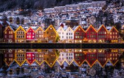 City Scene with Beautiful Glowing Snowy Houses at Bryggen royalty free stock photo